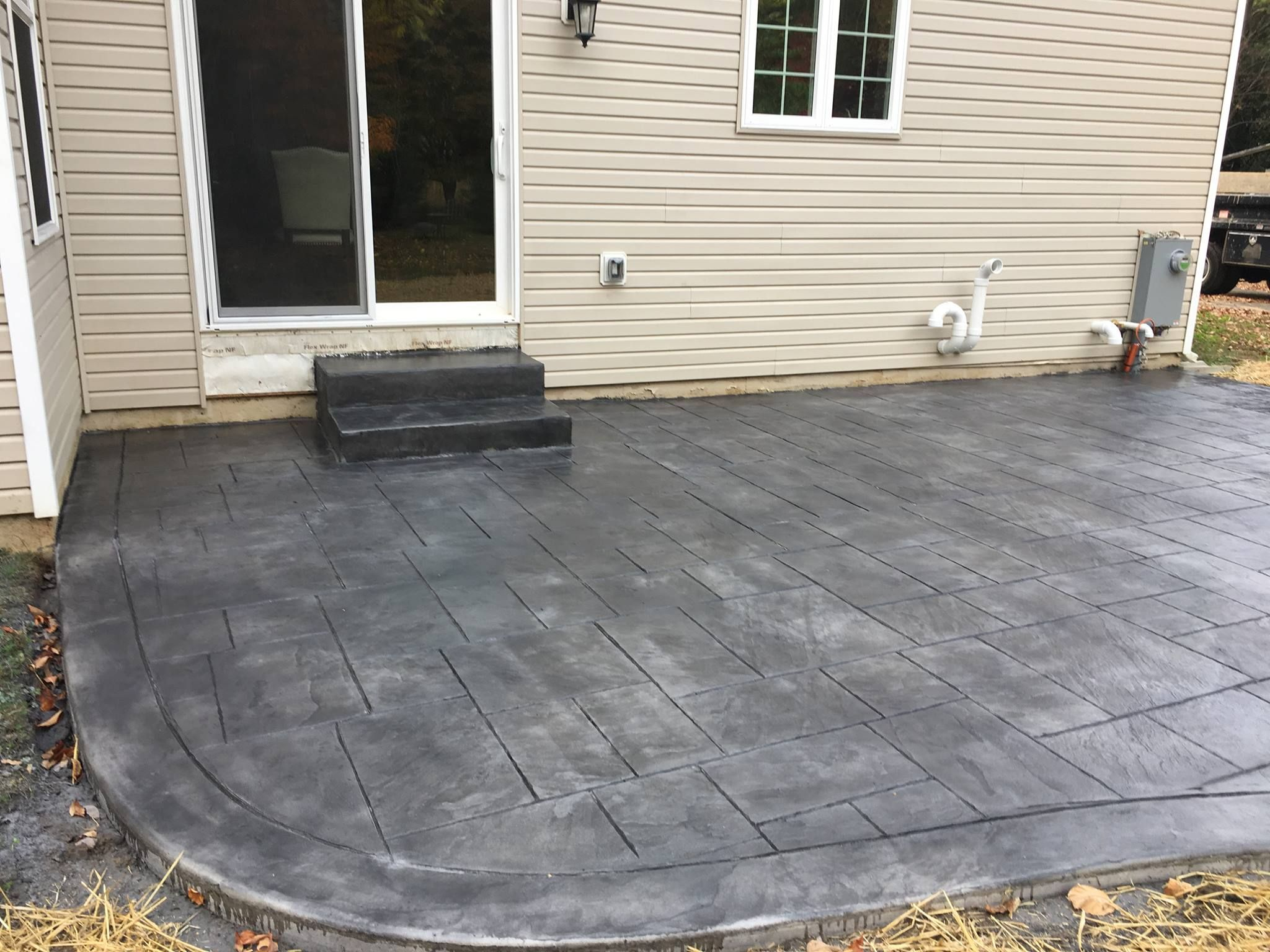 Stamped Concrete Patios Are A Great Low Maintenance Way To Add Texture To Your Yard Concrete Patio Stamped Concrete Patio Decorative Concrete Design