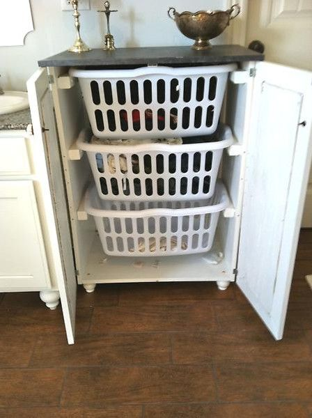 Dresser that can hide laundry baskets. No more clothes on