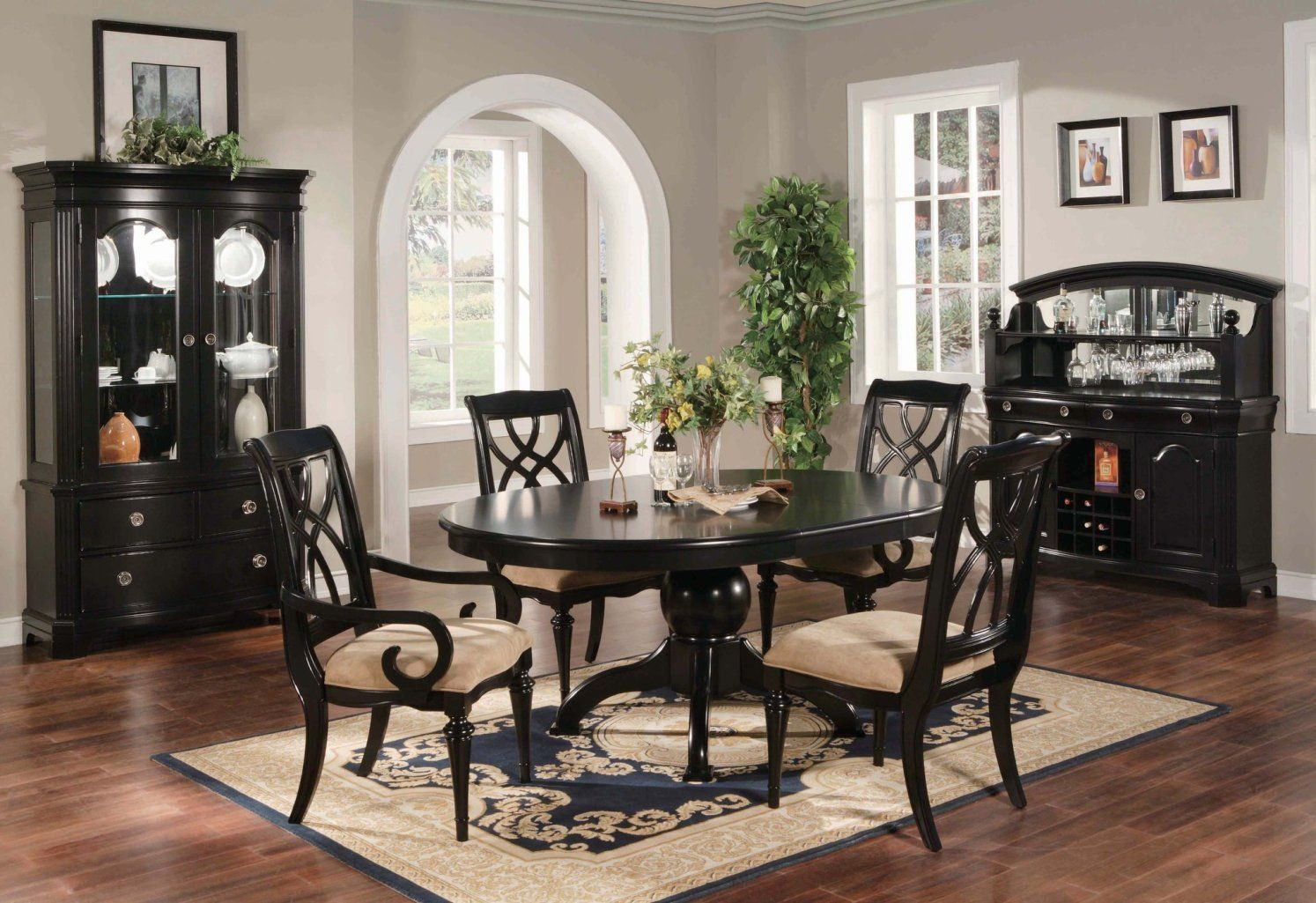 black dining table with wishbone chairs