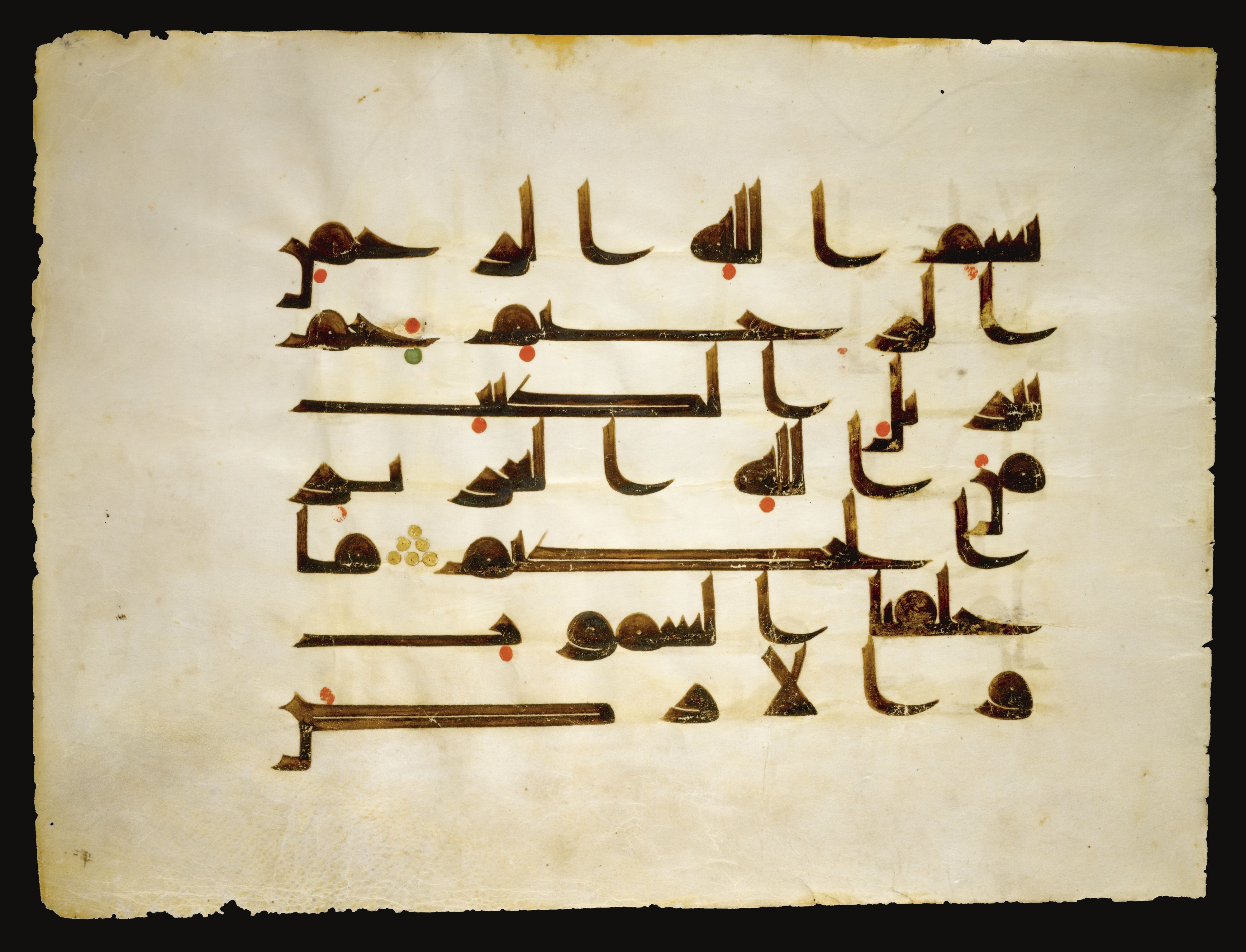 A large illuminated qur an leaf in kufic script north africa or