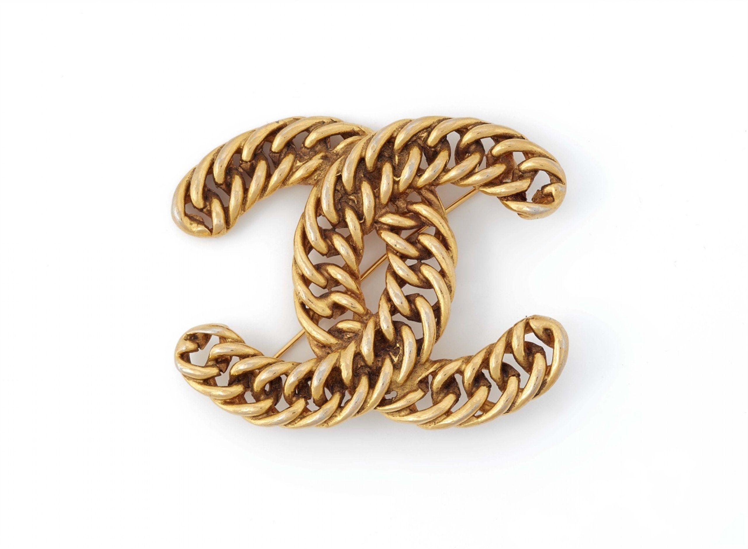 b3b4c86a Chanel, A Chanel logo brooch, 1982, Auction 1082 Hommage à ...