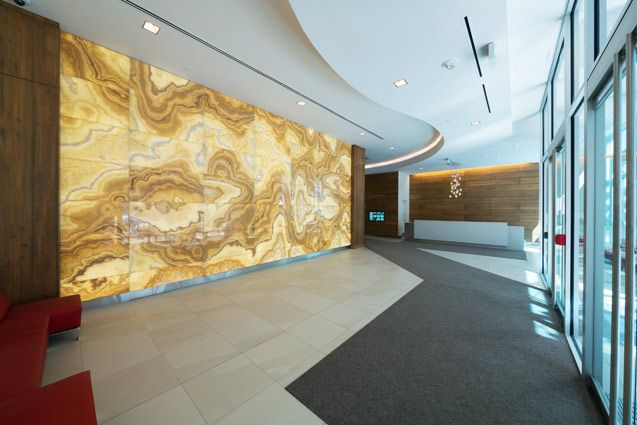 Backlit honey onyx feature wall panels by GPI Design make an ...