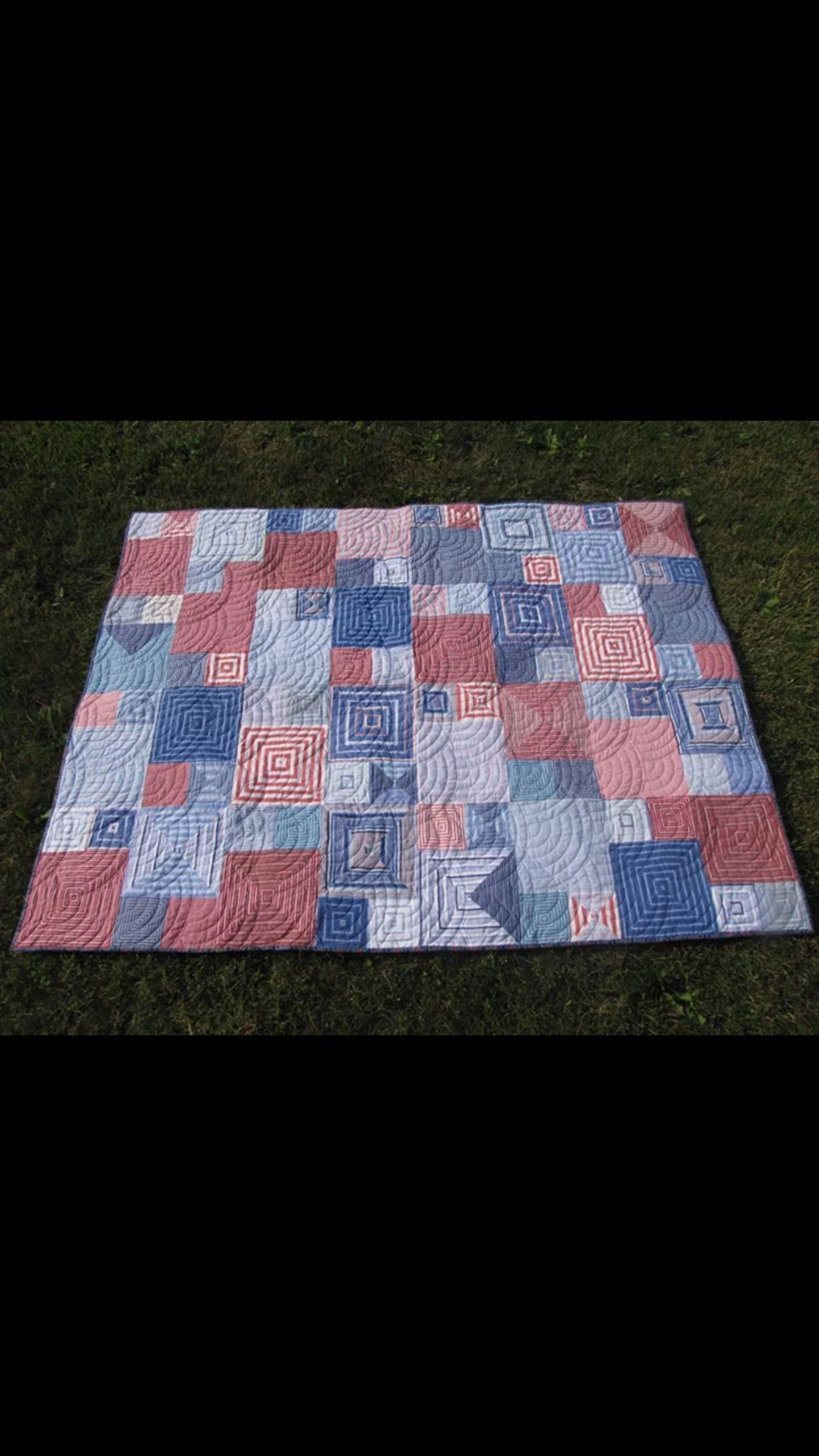 Quilt from old shirts.