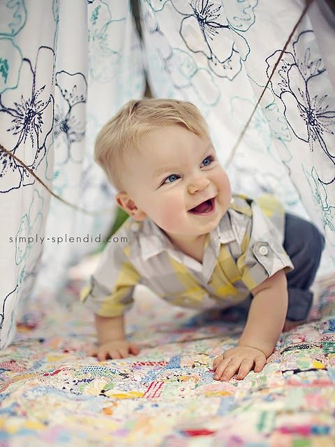 Love the idea of making a little sunlit cave with blankets and fabric -- a beautiful coloured backdrop and fun for bubs as well (not to mention hiding an ugly background).