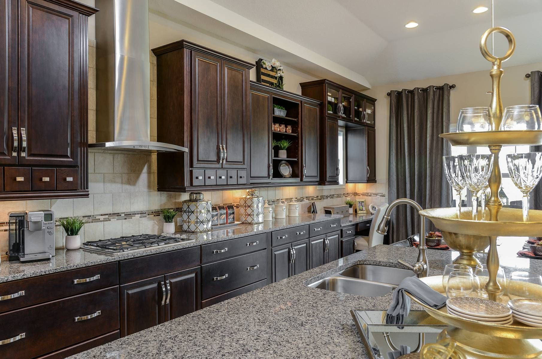 This Biscayne Ii Model Home Features Dark Cabinets With A Large Island Gourmet Kitchen Connerton Neighborhood Ta Kitchen Interior Dark Kitchen Cabinets Home