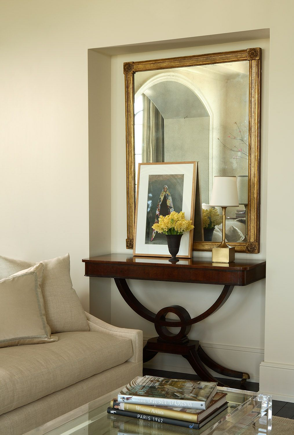 Art propped up in front of a mirror is such a lovely way to display it robert brown interior design