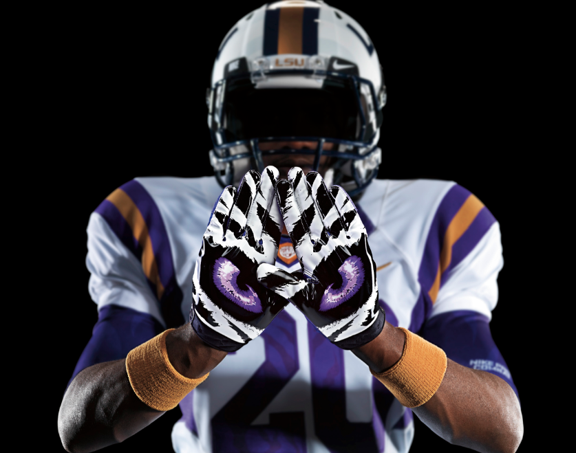 These Are The Nike Pro Combat Unis With Matching Gloves Mike Not Happy About Distorted Eye Color Lsu Tigers Football College Football Uniforms Lsu Tigers