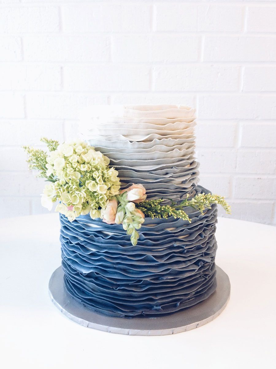 Blue Ombre Ruffle Wedding Cake With Small Arrangement Of Green Hydrangeas Caspias And Pale