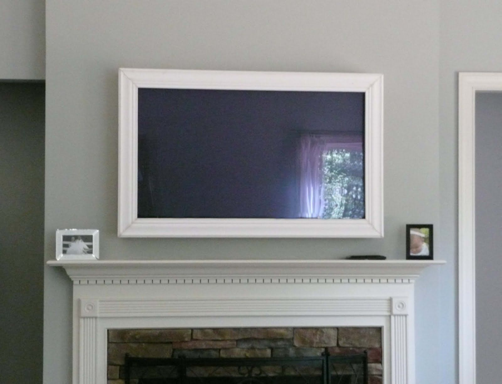 Framed tv and how to hide cords pinterest for ipad for How to wall mount a tv