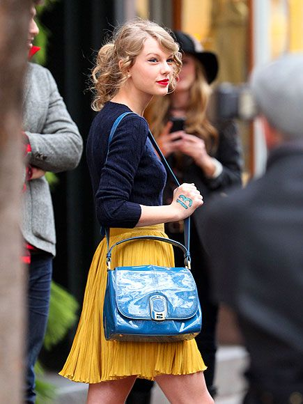 like the colors and sweater tucked into flowy skirt.. oh taylor.
