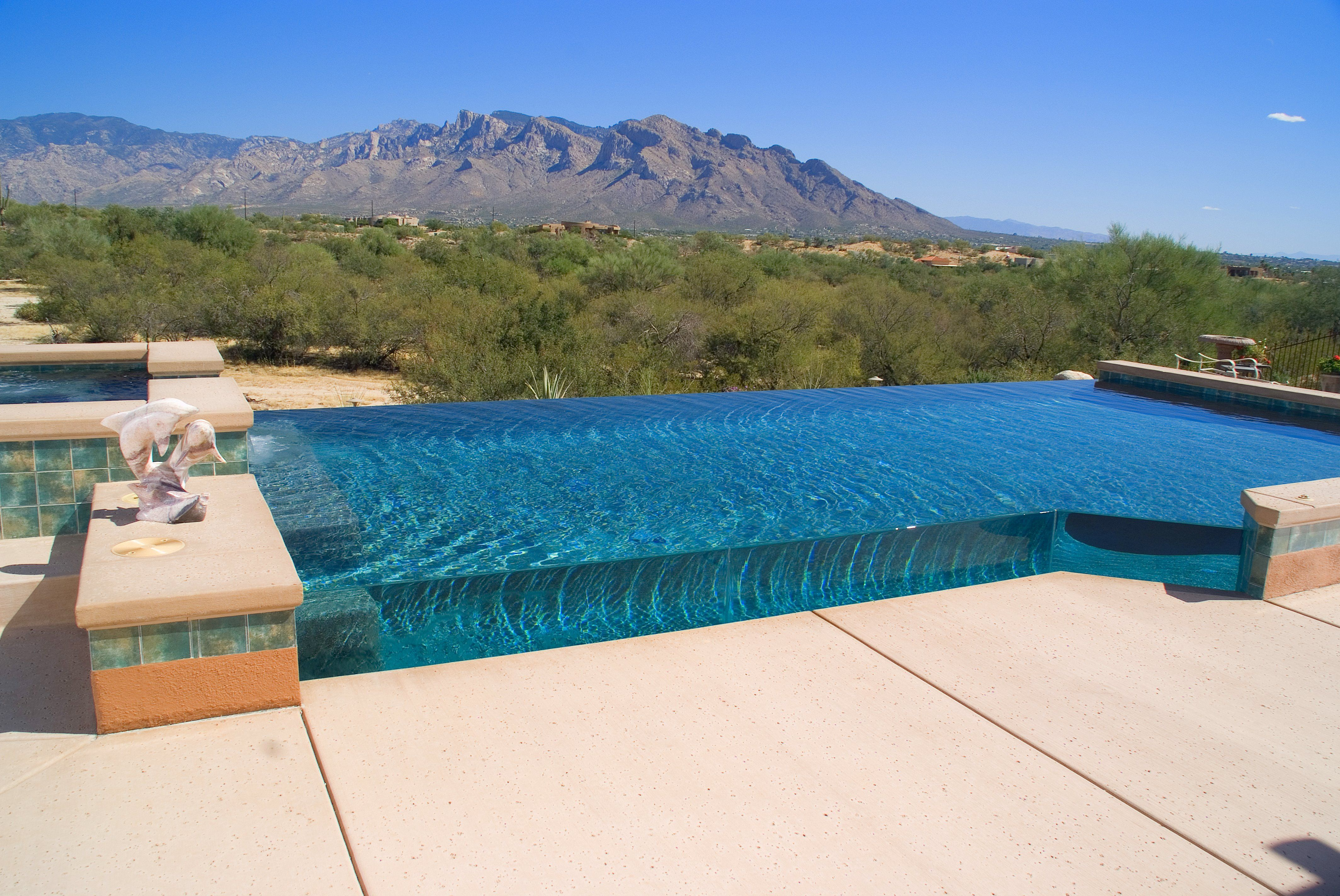 Pool with glass walls gorgeous homes gorgeous homes by - Infinity edge swimming pool ...