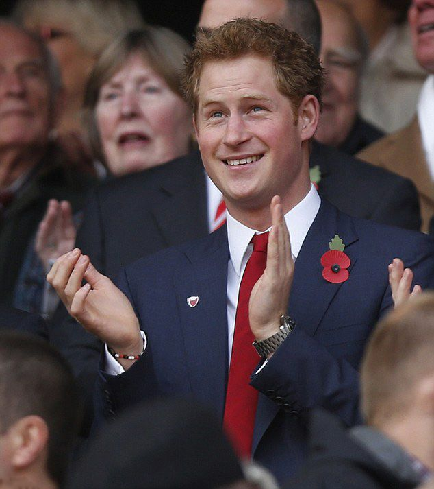 Prince Harry Dressed In A Smart Suit And Red Tie, The