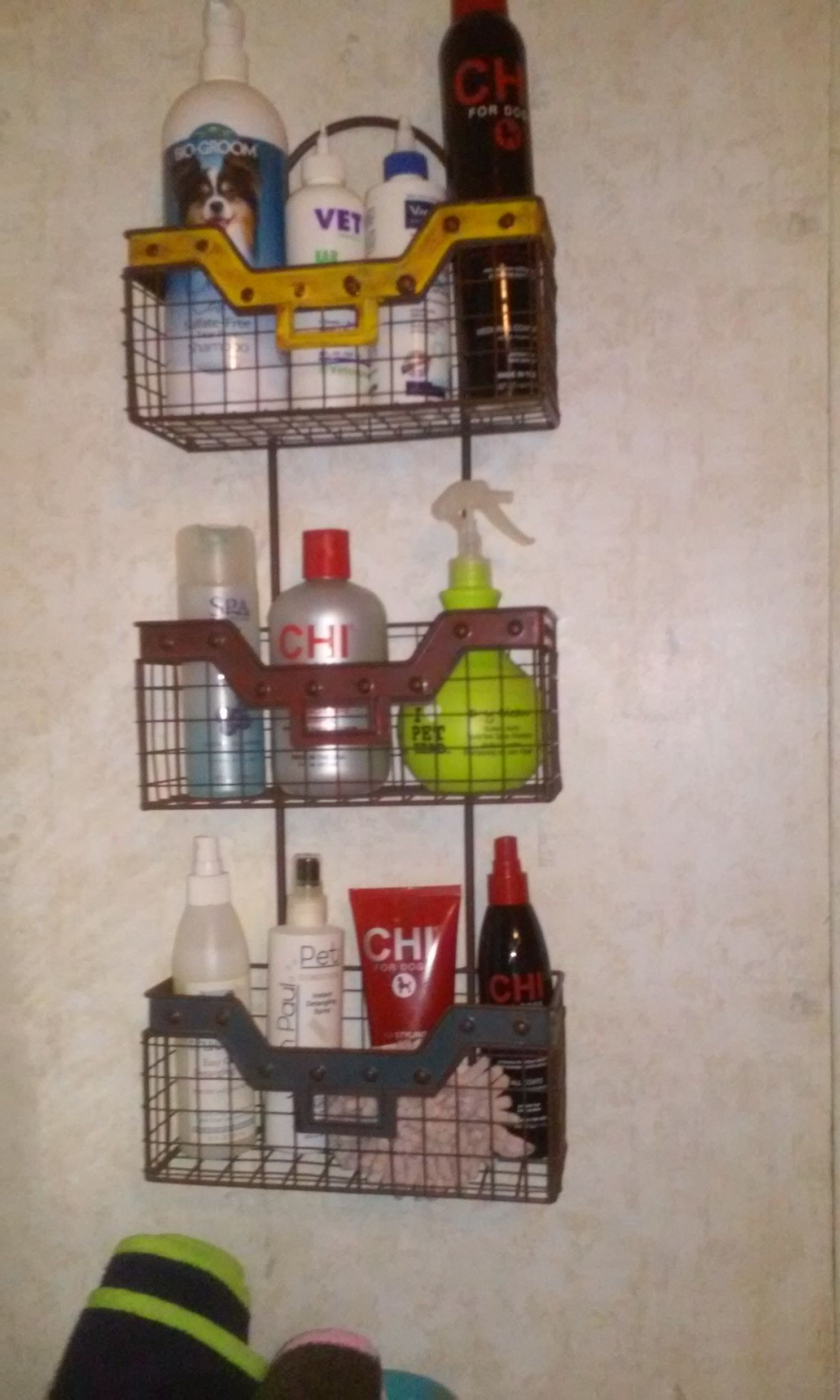 I got this rack at MIchael's for 70 percent off a while ago. Finally decided on a use for it. I hung it in my laundry room next to my deep sink. It holds shampoos, styling products, and ear cleaners for quick and easy dog grooming.Next I'll add some s-hooks at the bottom to hang the paw mops and washcloths for quick face washes.