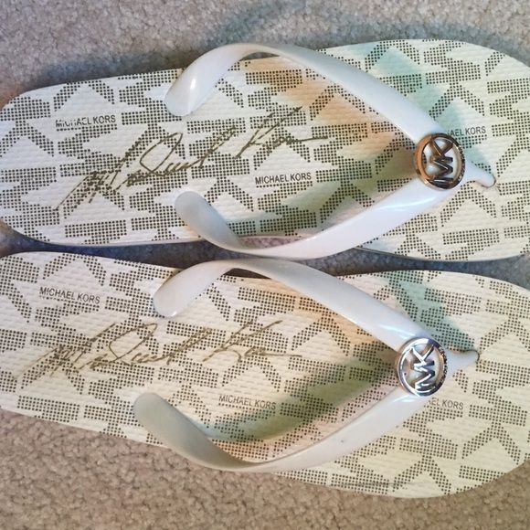 Michael Kors flip flops- Size 11 Wore once and they were too narrow for my foot. No sign on wearing except for bottom of shoe obviously other than that they are in like new condition Michael Kors Shoes Sandals