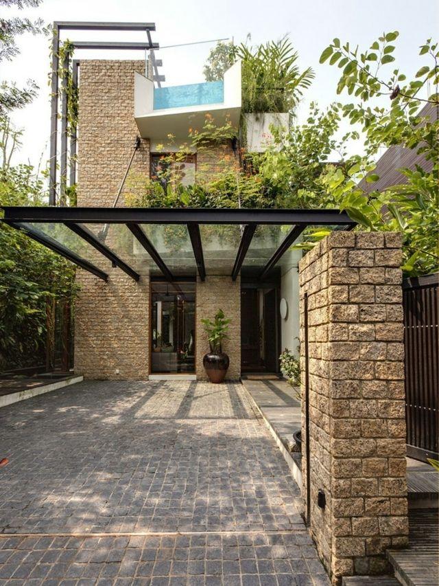 Exotische Villa Aus Stein Und Glas Mitten Im Stadtdschungel Exotische Mitten Stadtdschungel Stein Villa Carport Modern Moderner Eingang Gartengestaltung