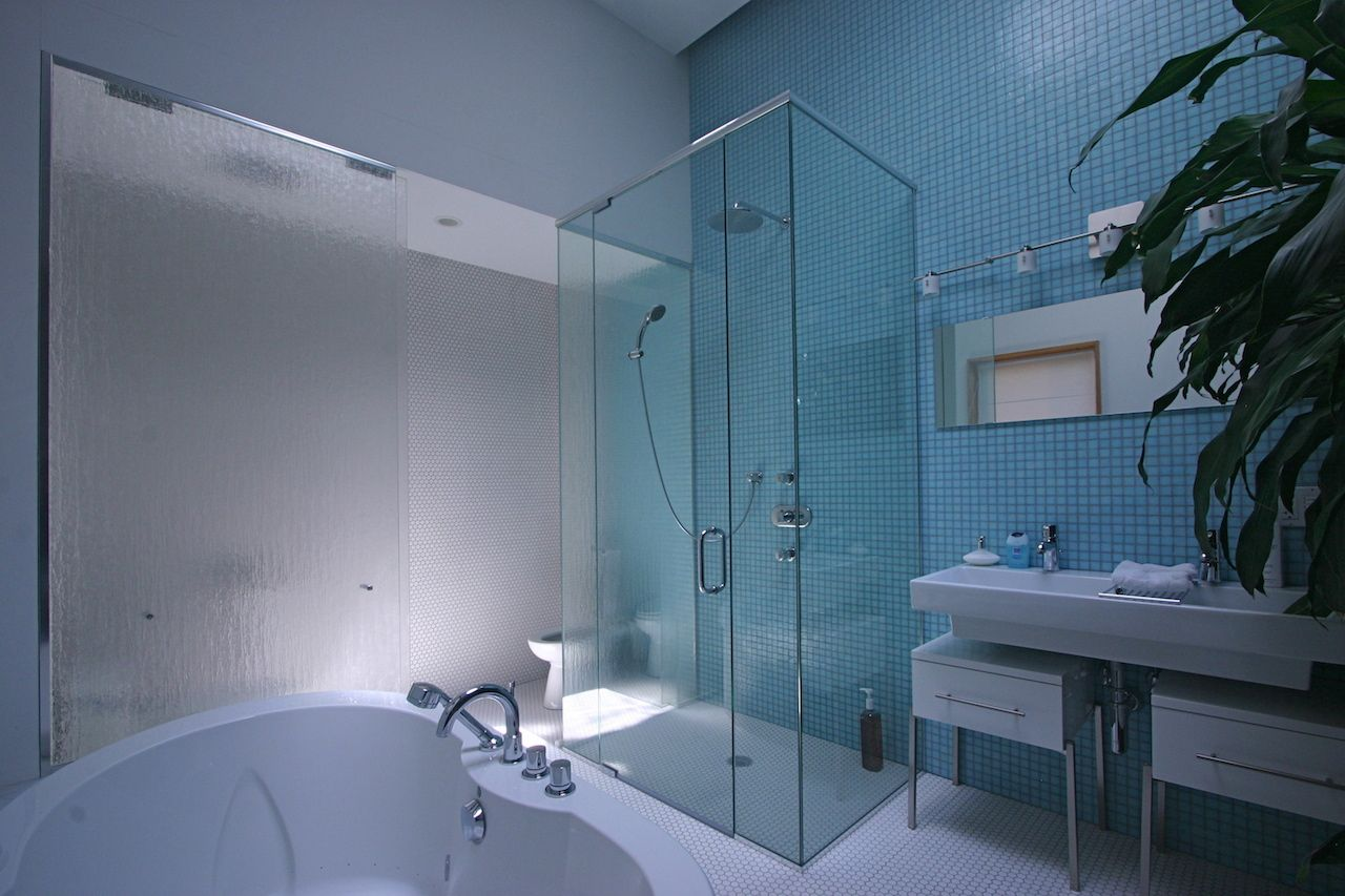 A Glass Elevator Style Shower Adds A Fun Contemporary Twist To Your Bathroom Behind An Area For The Toilet Is With Images Bathroom Design Sliding Glass Door Renovations