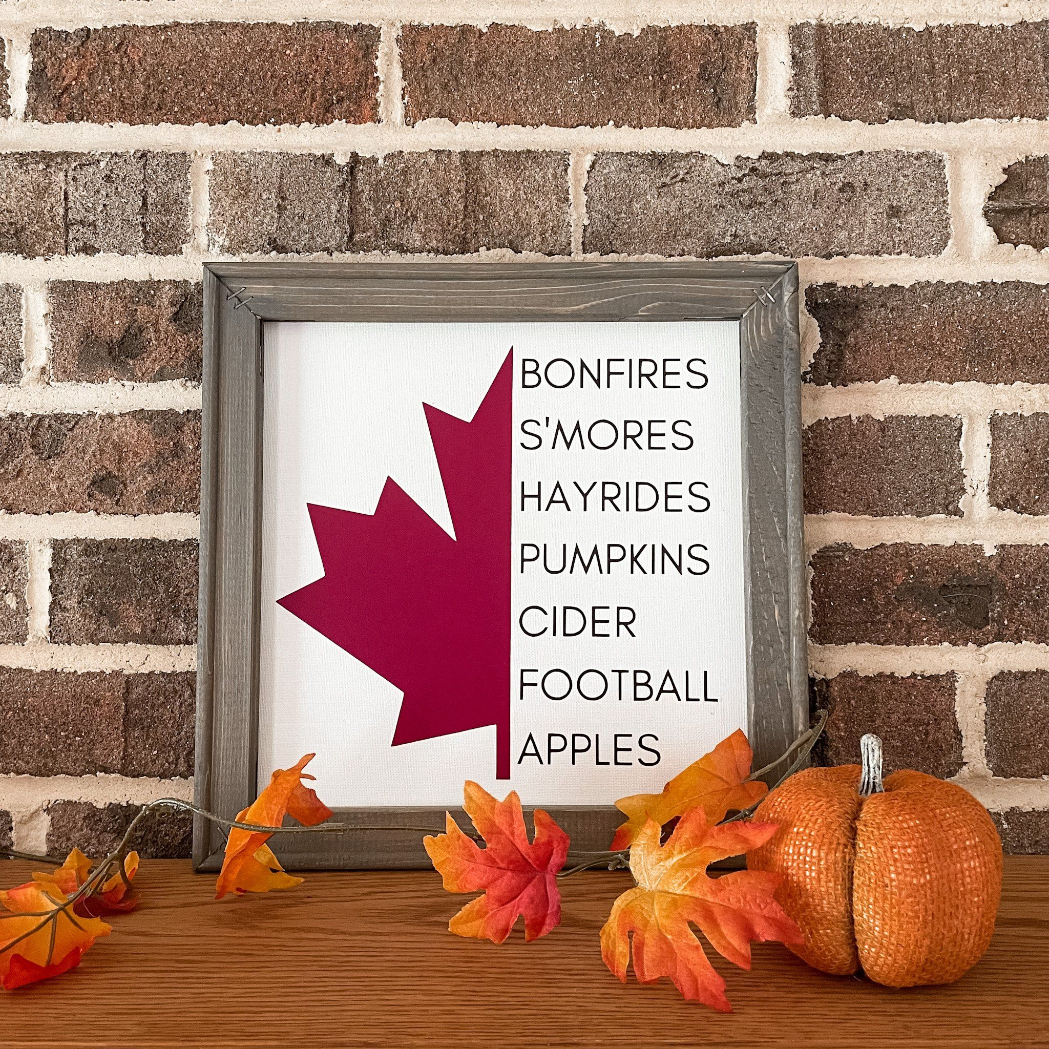 """All the fall things! These unique reverse canvas signs are hand pressed with high quality heat transfer vinyl onto canvas. The frames are hand stained with a premium wood stain. Hanging hardware is included. Sign measures 14""""h x 14""""w We love custom orders! Contact us to get started!"""