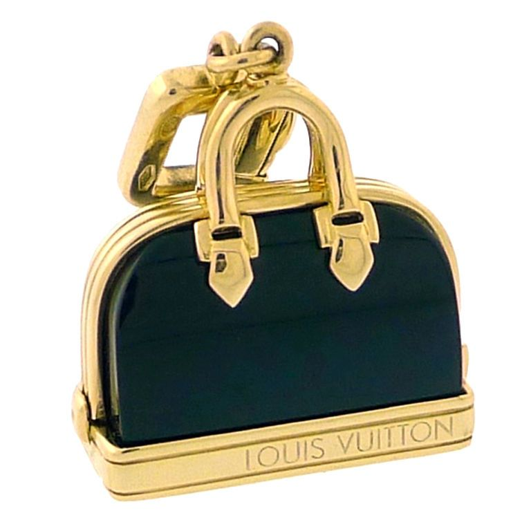 LOUIS VUITTON Alma Charm Yellow Gold & Onyx | From a unique collection of vintage charm bracelets at http://www.1stdibs.com/jewelry/bracelets/charm-bracelets/