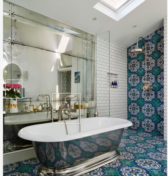 Bold cement tile on floor and accent wall mixed with white subway; large bath