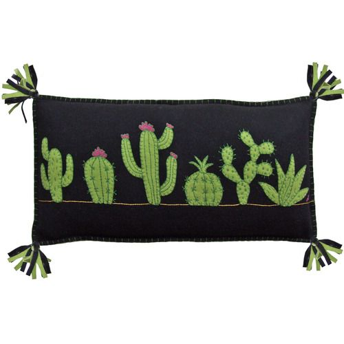 This fabulous Cactus cushion is made from black felt wool, appliquéd and hand embroidered with a row of quirky green cacti using blanket stitch, chain stitch and French knots.  The edges of the cushion are blanket stitched in green and the corners finished with  black and green felt tassels.