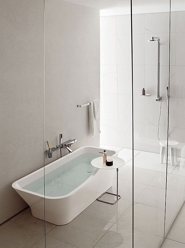 Separate Shower And Tub Share Space Behind A Glass Wall Use A Claw