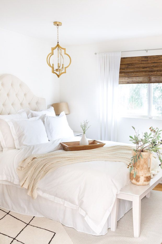Inviting White Fluffy Bed Chandelier and blinds Complete