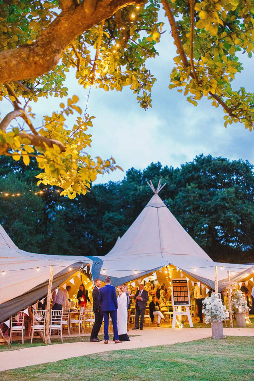 At Home Rustic Tipi Wedding with Navy Wedding Party Tipi