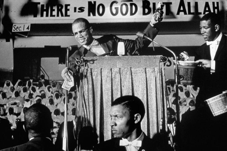 malcolm x gives a speech at a nation of islam rally