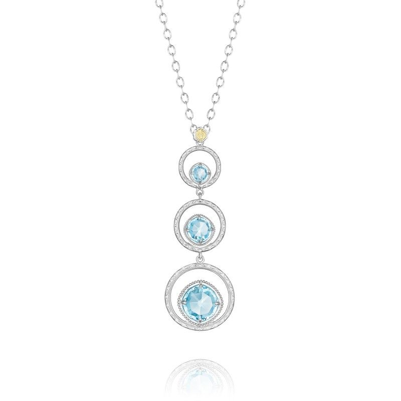 MSRP: $460.00  Like drops of dew, glistening on a bed of grass on a hot summer day, these three Sky Blue Topaz gems are nestled within three silver rings to create a dynamic design. Let each stone represent three important people in your life that you want to hold close to your heart. (Chain Included)