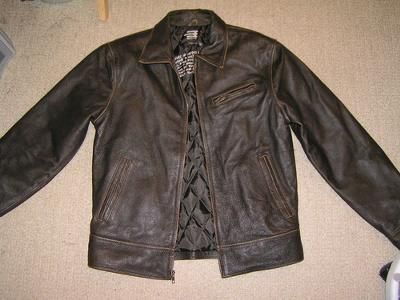 The video below gives tips for cleaning mildew from leather, such as a leather jacket.  She suggests mixing a solution of 1 part rubbing alcohol and 1
