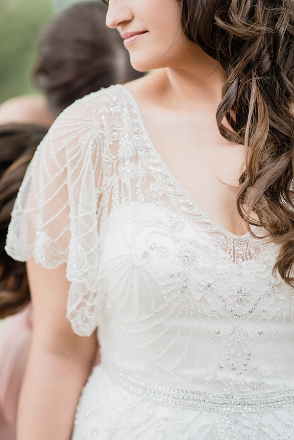 wedding dress detail - photo by Jenn Kavanagh Photography http://ruffledblog.com/blush-pink-canadian-wedding