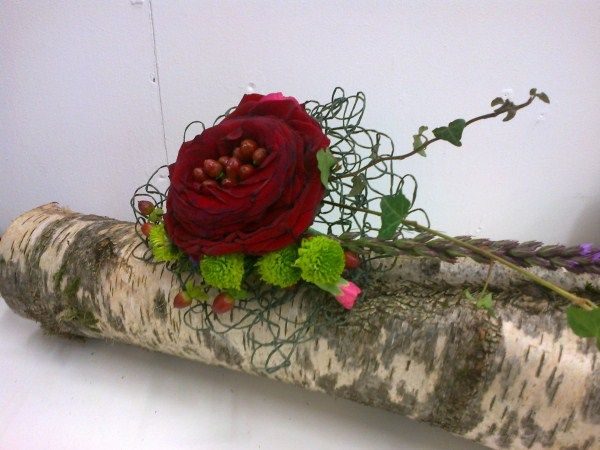 Sarah Tuhill, placed Hypericum Berries inside a carmen rose.