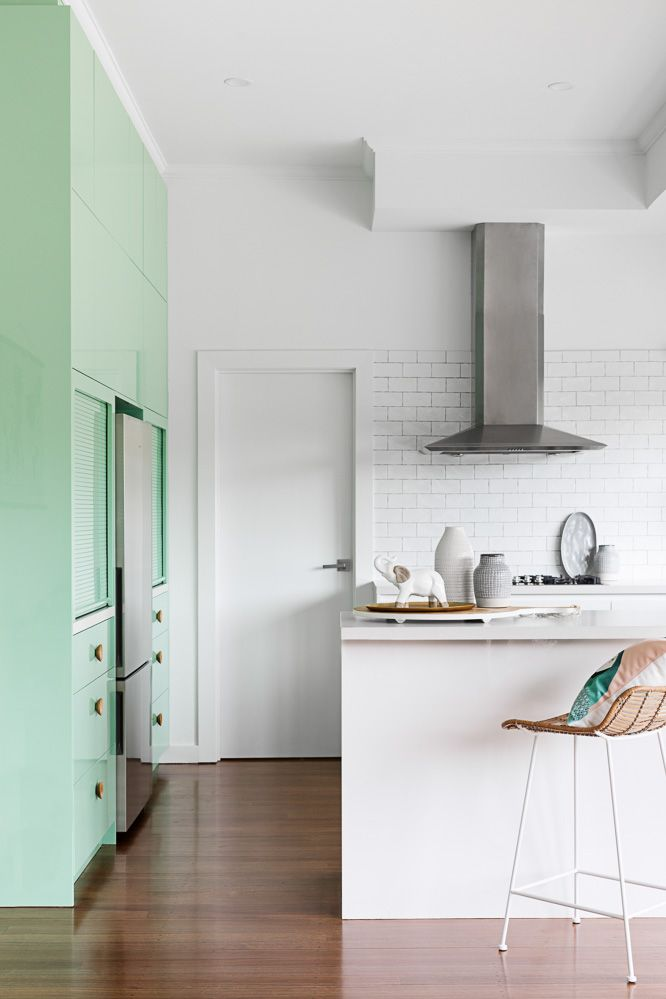 Mint green feature cupboards in this modern