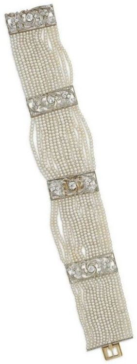 A BELLE ÉPOQUE SEED PEARL AND DIAMOND DOG COLLAR NECKLACE, BY TIFFANY & CO. Designed as fourteen-strands of seed pearls, with old-cut diamond openwork spacers and clasp of floral motif, circa 1895, mounted in platinum-topped gold, may also be worn as two bracelets. Signed Tiffany & Co., Paris. #Tiffany  #BelleEpoque #choker