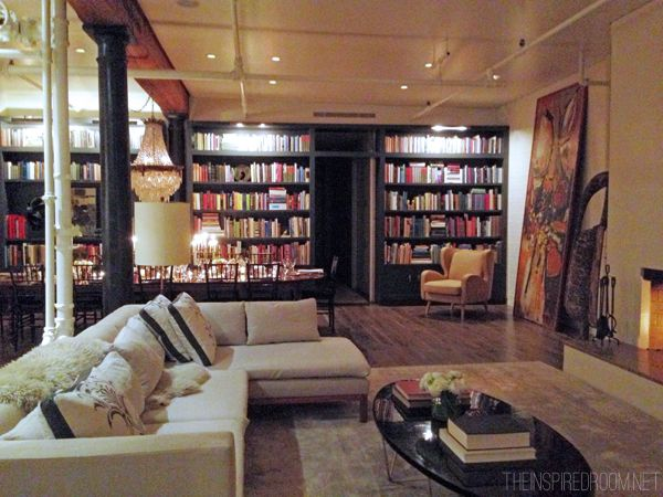 E Lemieux Soho New York Apartment Wall Of Books Oversized Artwork Leaning Against The Sectional Sofa
