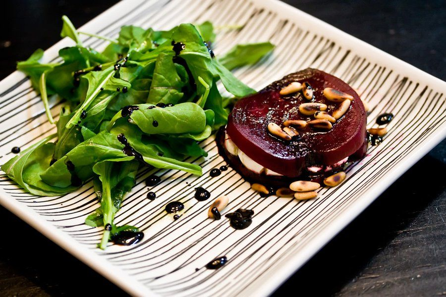 Beet stack: fresh cooked beets with goat cheese, toasted pine nuts, and arugala. Drizzled with extra virgin olive oil and a balsamic reduction.