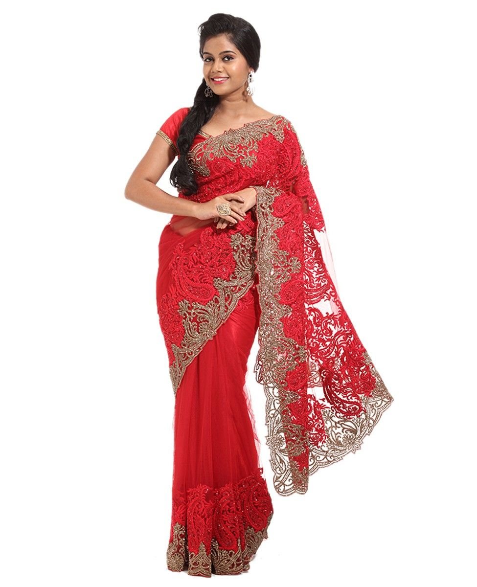 Net Fabric Designer Party Wear Saree. Body is red net. Border and Pallu with heavy red thread and red stone work along with heavy antique stone work. Net designer blouse including red stone work.