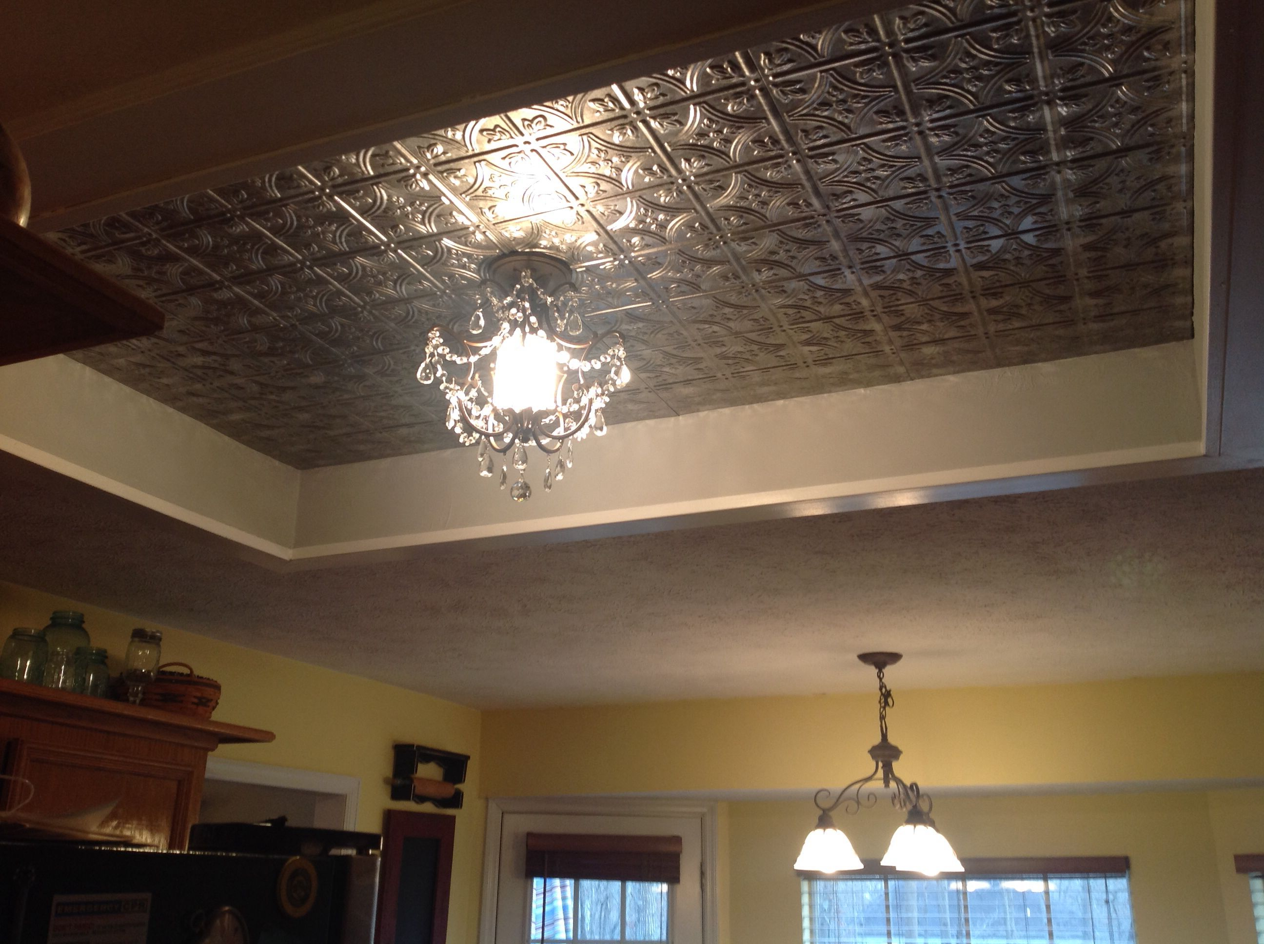 Replaced fluorescent box light with tin tiles.