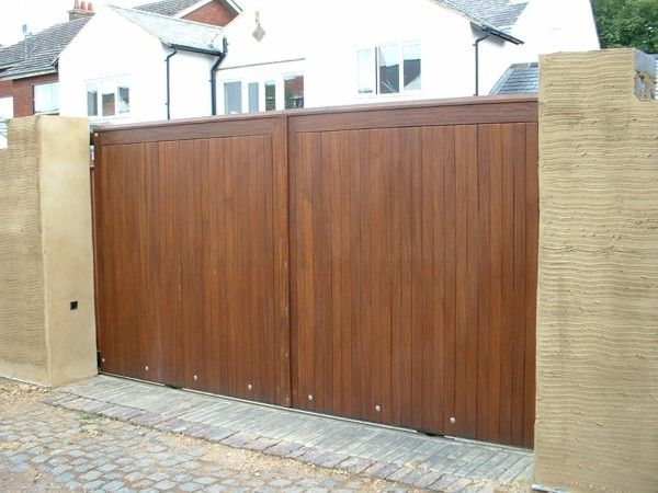Wooden Sliding Gates Residential Commercial Electric Gates Agd Systems In 2020 Gate Design Sliding Gate Wooden Gate Designs