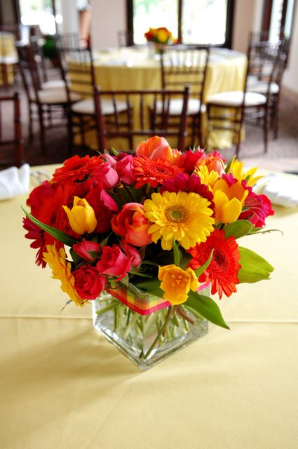 This centerpiece was created with yellow and orange gerber