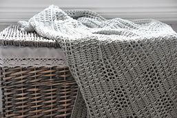 The Silver Squares Blanket is just the thing for any new arrival.