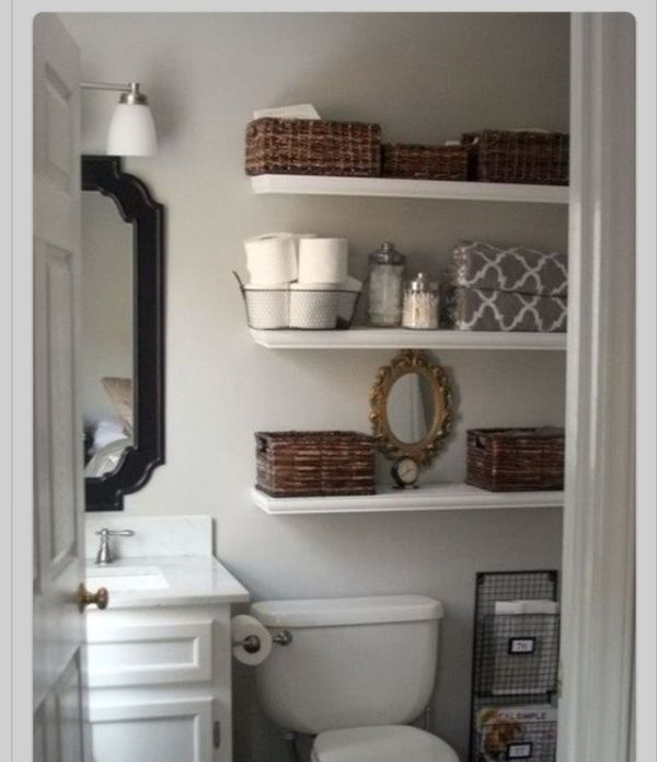 Small bathroom makeover love the floating shelves and storage next to the toilet half bath idea Trending - Minimalist small bathroom shelf ideas