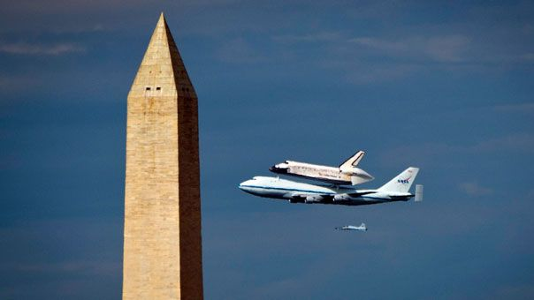 The Discovery shuttle piggybacks past the Washington Monument, marking a 30yr era in spaceflight finally going into the history books, well, actually into the Smithsonian.