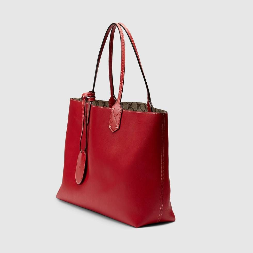 d46bd6981514 Shop the Reversible GG medium tote by Gucci. Medium-size lightweight  carryall made with our innovative reversible leather, patented exclusively  to Gucci.