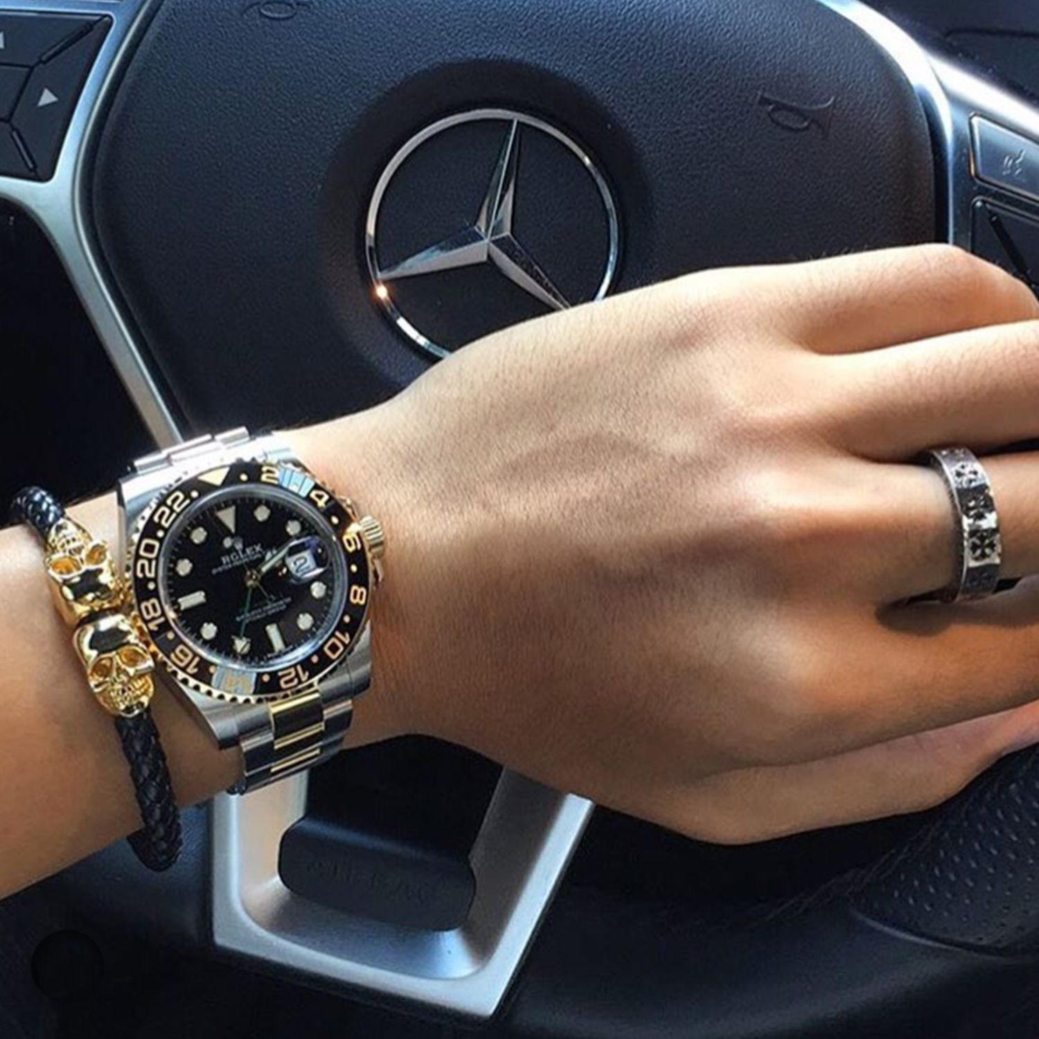 Fan Instagram Pic ! | While behind the wheel of his Mercedes @leo.tien shared a picture of his Northskull premium Black Nappa Leather & Gold Twin Skull Bracelet paired nicely with his Rolex GMT-Master II 40mm Watch. Strong Look! | Available now at Northskull.com | For a chance to get featured post a cool photo of your Northskull jewelry with the tag #Northskullfanpic on Instagram. #rolexwatches