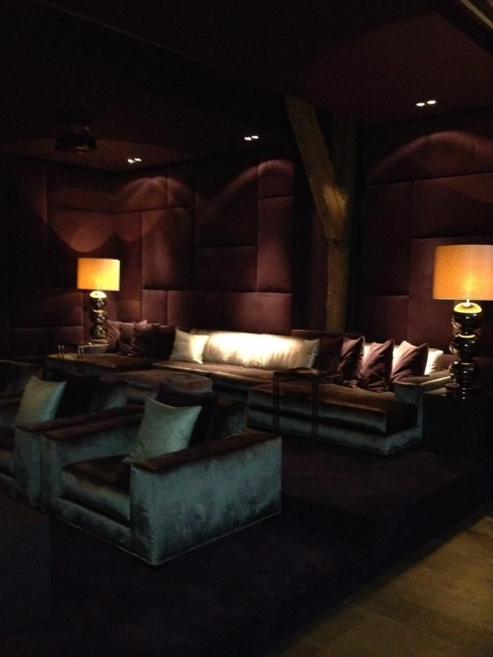 The colours in this cinema room give a luxurious feel and the upholstered  wall panels offer another element of luxury, but this is a very specific  style