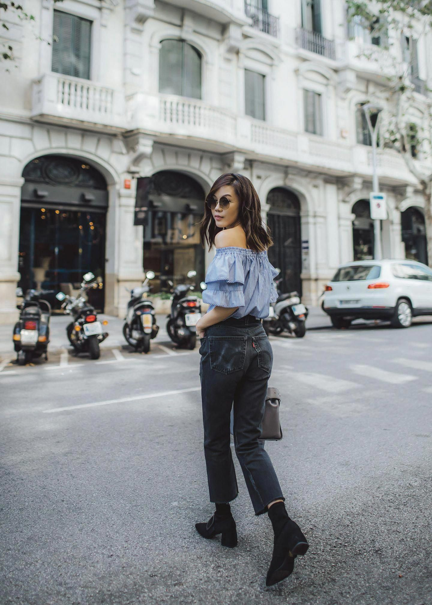 67352f68cc1 Lifestyle fashion travel blogger Jenny Tsang of Tsangtastic wearing off  shoulder ruffle sleeve top and re done levis jeans and roger vivier leather  bag in ...