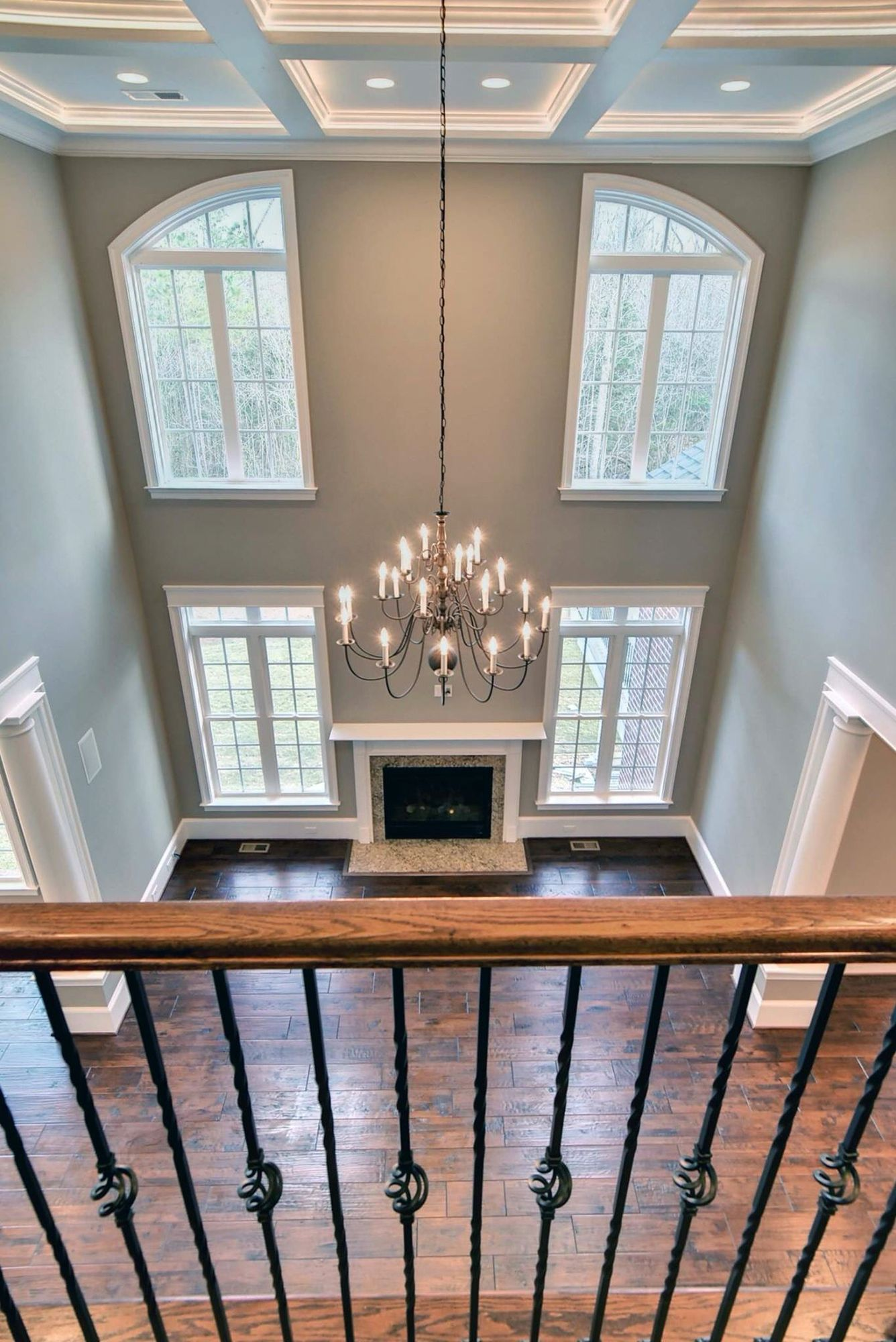 Two Story Family Room With Coffered Ceilings Recessed Lighting