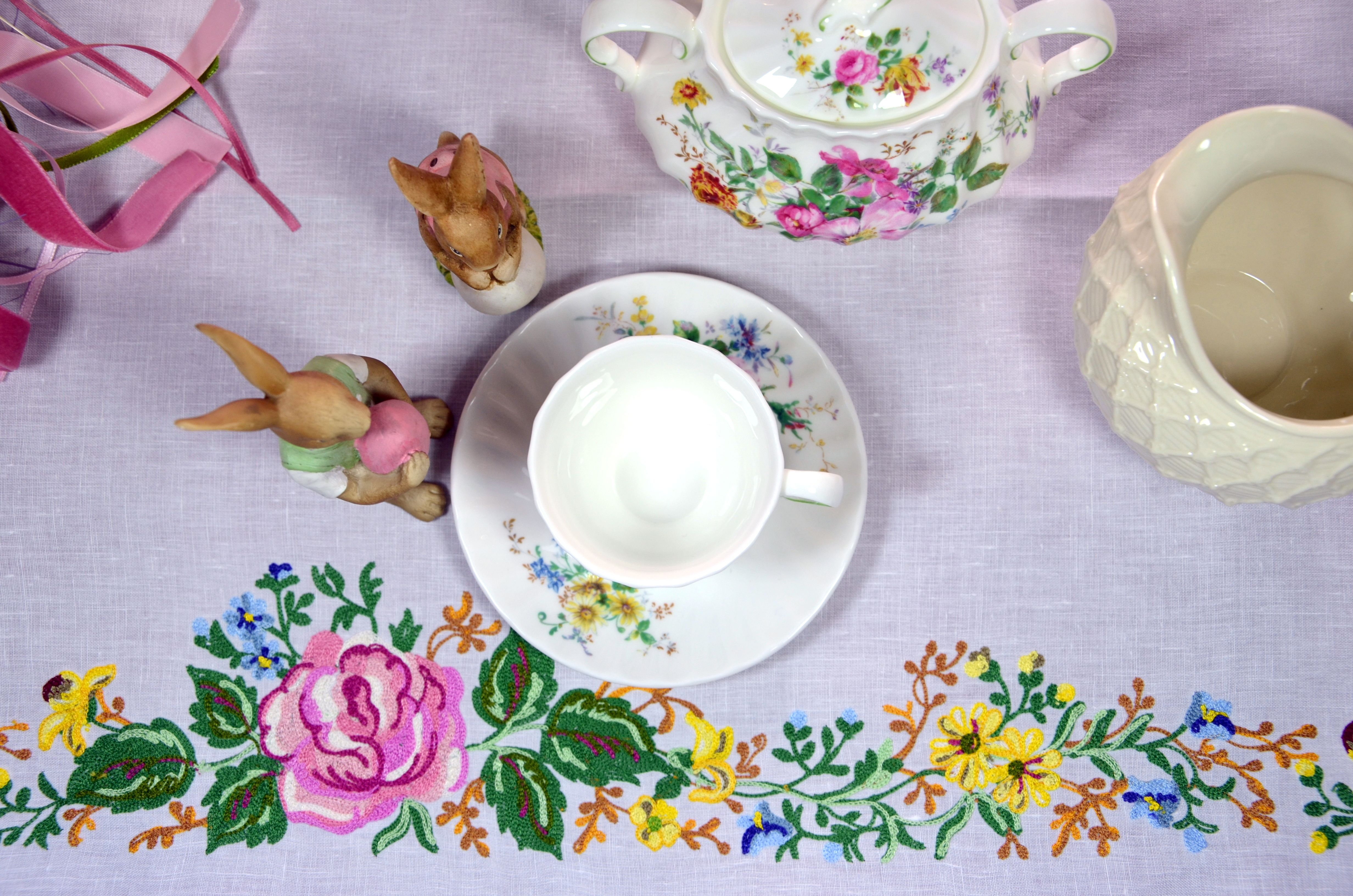 Embroidered tablecloth and porcelain tea cup!
