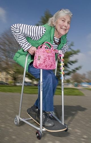 Skateboarding granny...now that's the way a walker should ...